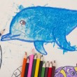 Child's drawing a dolphin and pencils — Stock Photo