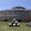 Stock Photo: Canon balls, in Rhodes old town moat.