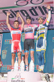 MILAN, ITALY - MAY 27: Podium of Giro d'Italia 2012 with 1st arrived Ryder Hesjedal wearing the Pink Jersey, 2nd Joaquin Rodriguez and 3rd Thomas De Gendt on May 27, 2012 in Milano, Italy — Stock Photo