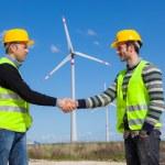 Engineers giving Handshake in a Wind Turbine Power Station — Stock Photo