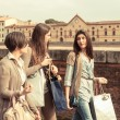 Young Women in the city after Shopping - Stock Photo