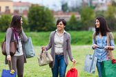 Young Women at Park after Shopping — Stockfoto