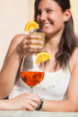 Happy Young Woman Drinking with Cold Drink in Foreground — Stock Photo