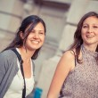 Two Young Women Walking in the City — Stock Photo