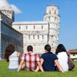 Four Friends on Vacation Visiting Pisa - Stock Photo