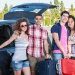 Four Friends Ready to Leave For Vacation — Stock Photo #11043538