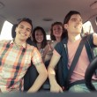 Four Friends in a Car Leaving For Vacation — Stock Photo