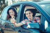 Boy and Girl in a Car Leaving for Vacation — Stock Photo