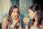 Two Young Women with a Cold Drink — ストック写真
