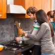 Stock Photo: Happy Multiracial Couple in Kitchen