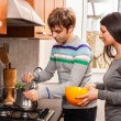 Happy Multiracial Couple in Kitchen — Stock Photo #11111808
