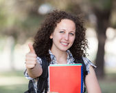 Young Beautiful Female Student with Thumb Up — Stock Photo