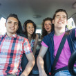 Royalty-Free Stock Photo: Four Friends in a Car Leaving For Vacation