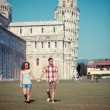 Young Couple of Tourists in Pisa - Stock Photo