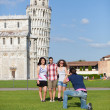 Group of Friends Taking Photo with Pisa Leaning Tower on Background — Stock Photo