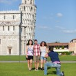 Group of Friends Taking Photo with Pisa Leaning Tower on Background - Stock Photo