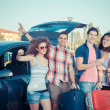 Four Friends Ready to Leave For Vacation — Stock Photo #11420376