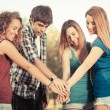 Group of Teenagers with Hands on Stack — Stockfoto