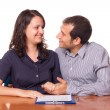 Happy Young Couple with Important Document to Sign — Stock Photo