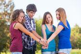 集团的青少年用堆栈上的手 — 图库照片