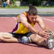 Track and Field Athlete Stretching — Stock Photo #11552990