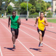 Stock Photo: Two Track and Field Athletes Running
