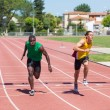 Two Track and Field Athletes Running — Stock Photo