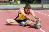 Track and Field Athlete Stretching — Stock Photo