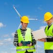 Two Engineers in a Wind Turbine Power Station — Stock Photo #11747167