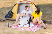 Young Couple Camping and Cheering — Stock Photo