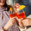 Two Young Women Cheering with Cold Drinks — Stock Photo #11995299