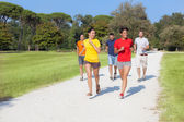 Group of Friends Running Outside — Stock Photo