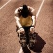 Track and Field Athlete Stretching — Stock Photo #12011719