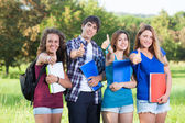 Teenage Students with Thumbs up — Stock Photo