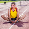 Track and Field Athlete Stretching — Stock Photo #12126816