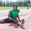 Track and Field Athlete Stretching — Stock Photo #12126910