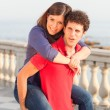 Smiling Young Couple Piggybacking — Foto Stock