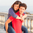 Stockfoto: Smiling Young Couple Piggybacking