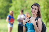 Young Female Student at Park with Other Friends — Stok fotoğraf