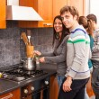 Happy Multiracial Couple in Kitchen — Stock Photo #12390346