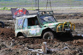 Offroad race 4x4 car in the bog. — Stock Photo