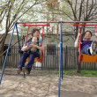 Family on swing — Stock Photo