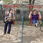 Happy family on swing — Stock Photo