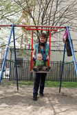 Mother swinging her son — Stock Photo