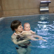 Mother holding child in pool — Stock Photo #11102008