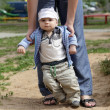 Baby boy taking first steps — Stock Photo #11319479
