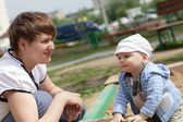 Mother with child outdoors — Stock Photo