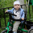 Child on tricycle - Stock Photo