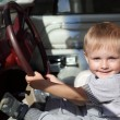 Stock Photo: Happy child in car