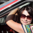 Happy woman in car — Stock Photo #11534077